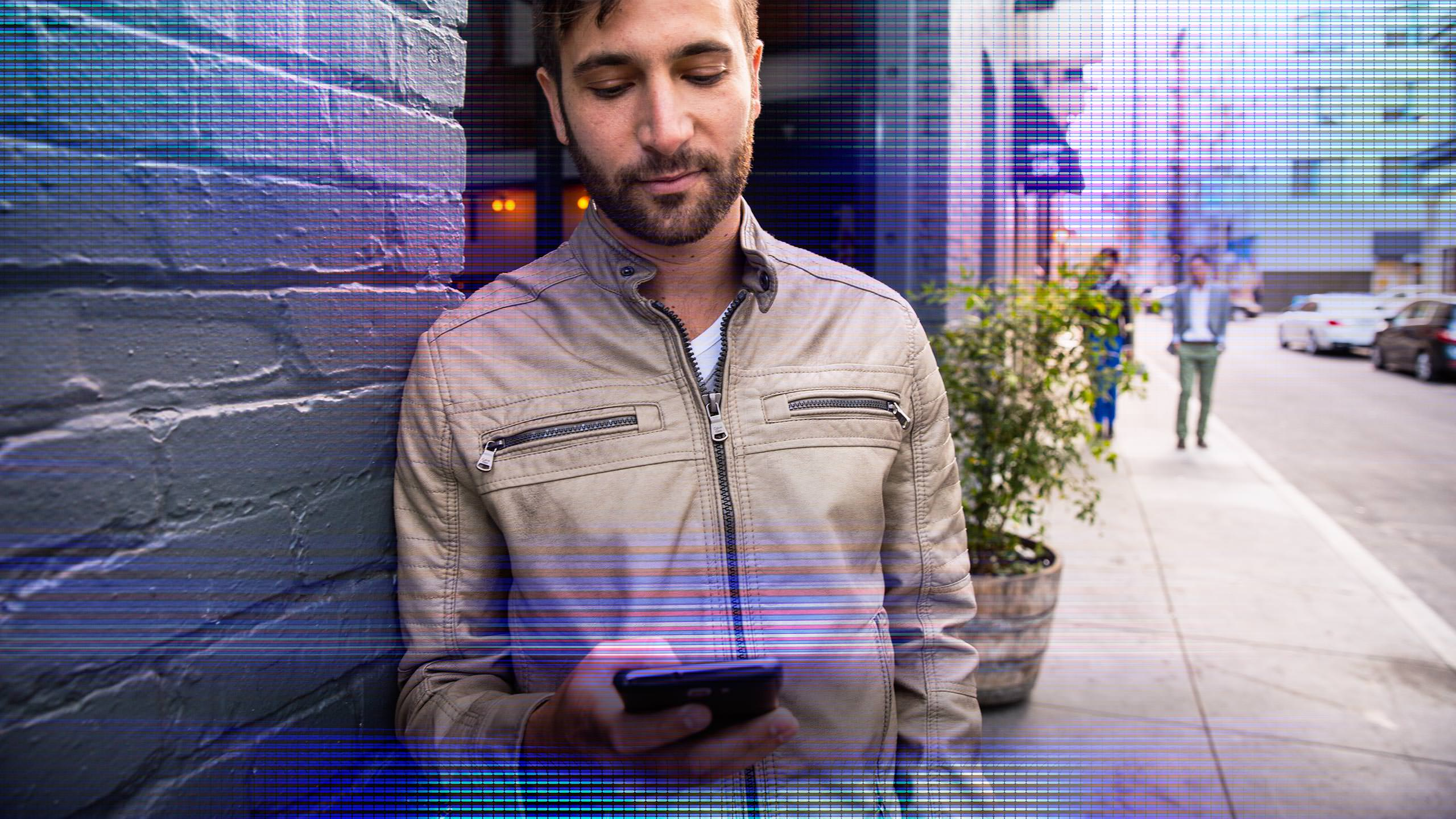 Citrix Brand Photography - Man with mobile phone on street