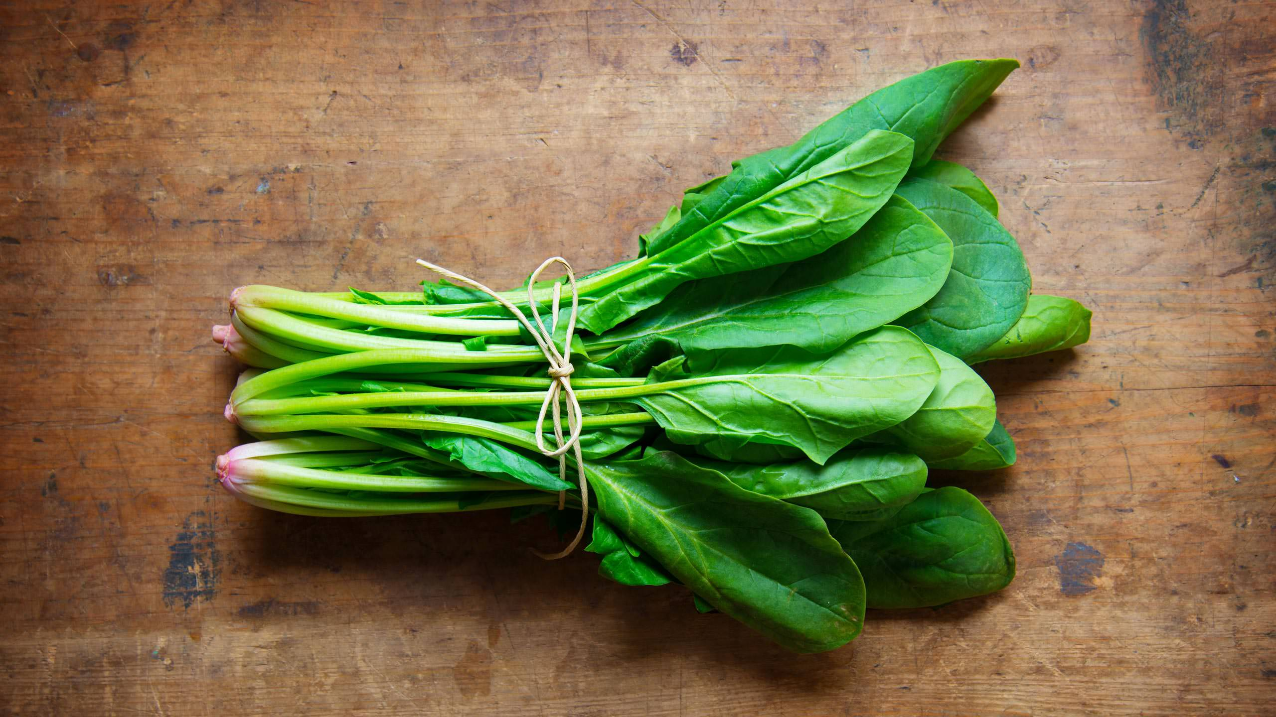 See-Jane-Farm-photograph-spinach-wood-surface